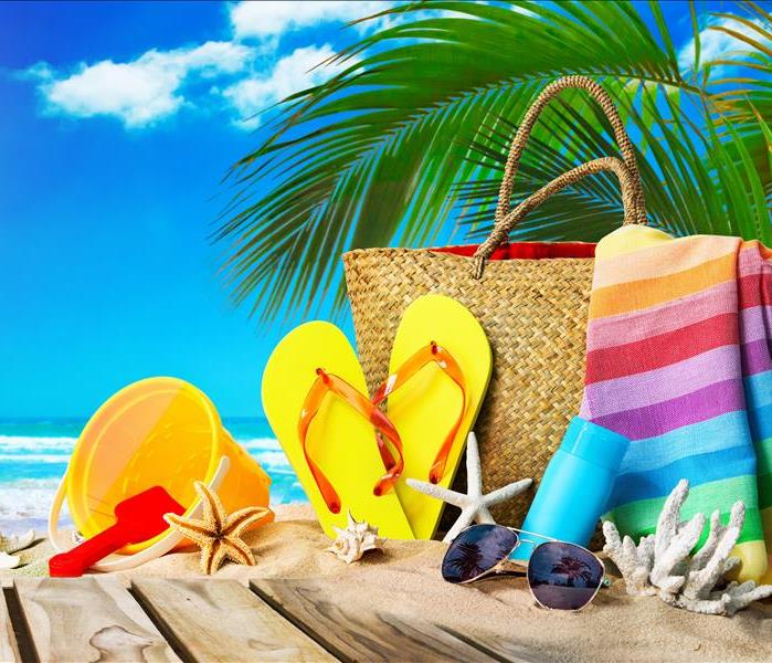 tropical beach with sunbathing accessories