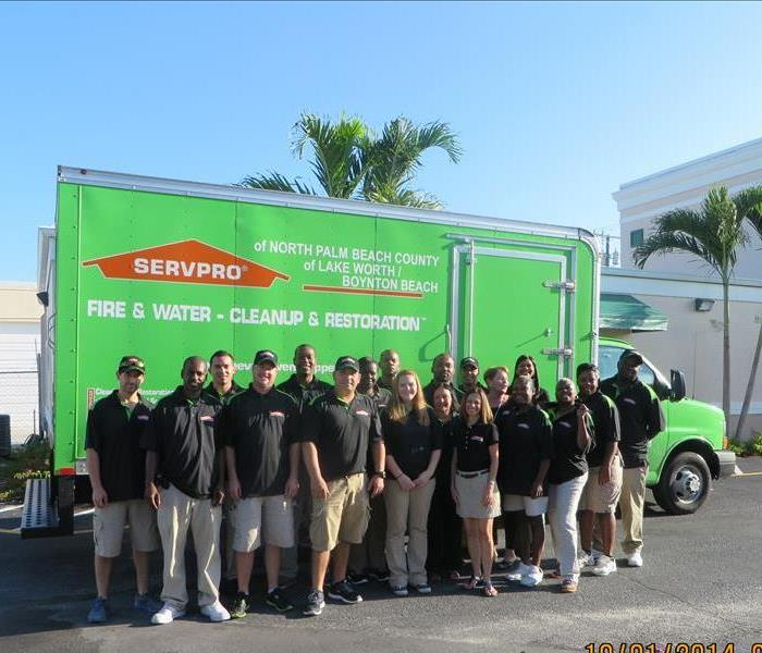 Some of the SERVPRO of North Palm Beach County team posing in front of one of our trucks