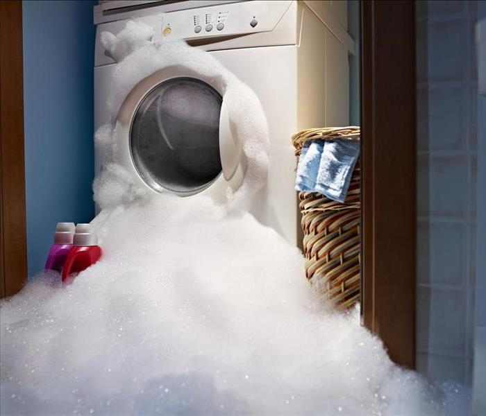 washing machine with suds overflowing